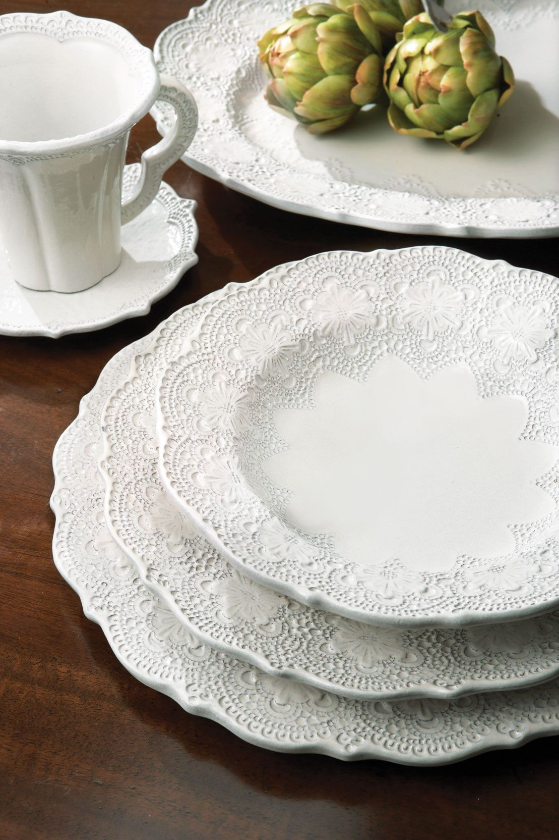 For a romantic table setting I like the lacey look of the Merletto series by Arte Italica. They also have this dinnerware in aqua and taupe. & For a romantic table setting I like the lacey look of the Merletto ...