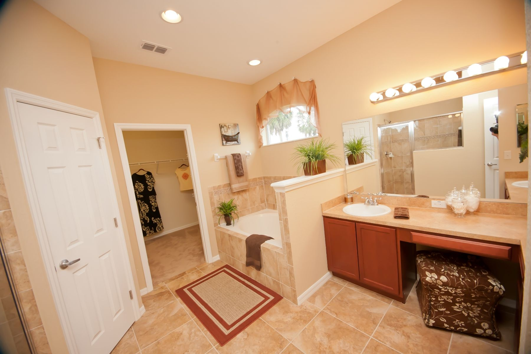 L-shaped vanity, garden tub, tiled shower, spacious walk-in closet ...