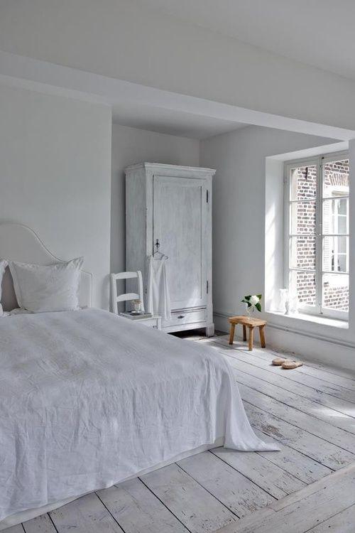 white bedroom full of light.  Needs a little color, but I like the floor