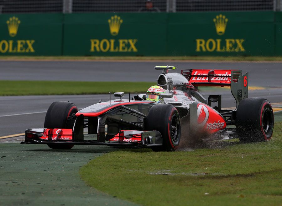 sergio perez runs wide as he struggles with slick tyres on a damp rh pinterest com