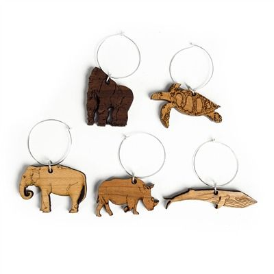 Sustainable Wood Animal Wine Charms - Choose your spirit animal. These beautiful, intricately designed wine charms are laser-cut from sustainably harvested FSC certified wood. Includes Rhino, Gorilla, Blue Whale, Elephant and Sea Turtle charms so you can keep track of your drink with your favorite animal. The perfect stock stuffers!