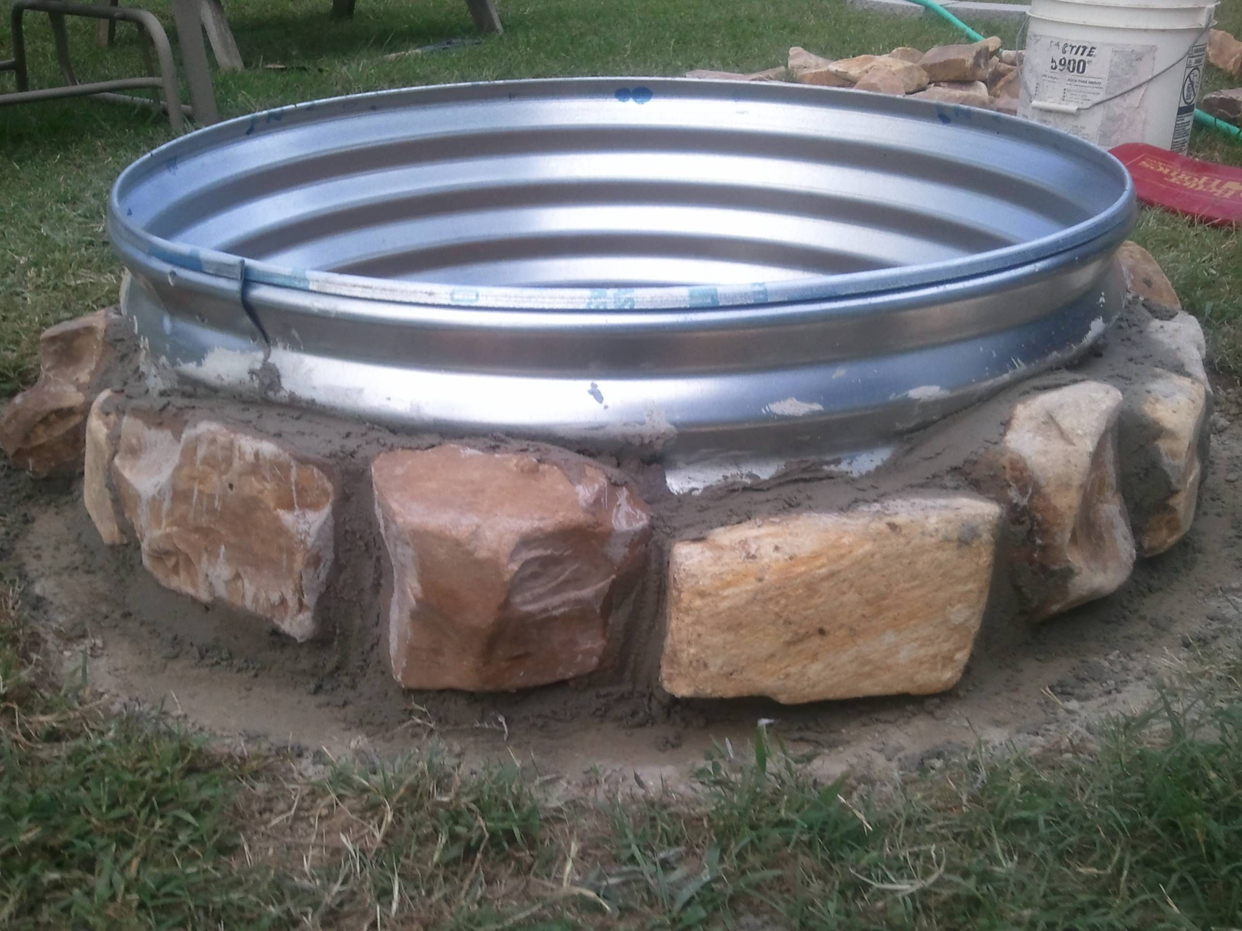 DIY FirePit for $20: Buy a 15 gallon wash pail from Lowe's. They ...