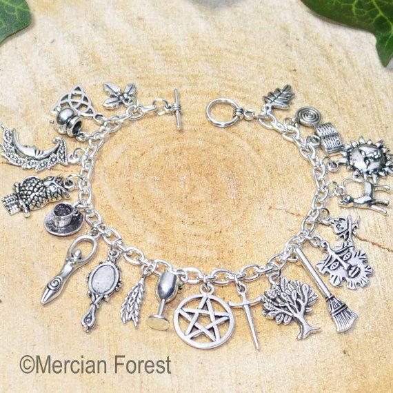 Pagan Wiccan Charm Bracelet with 21 charms Handmade.