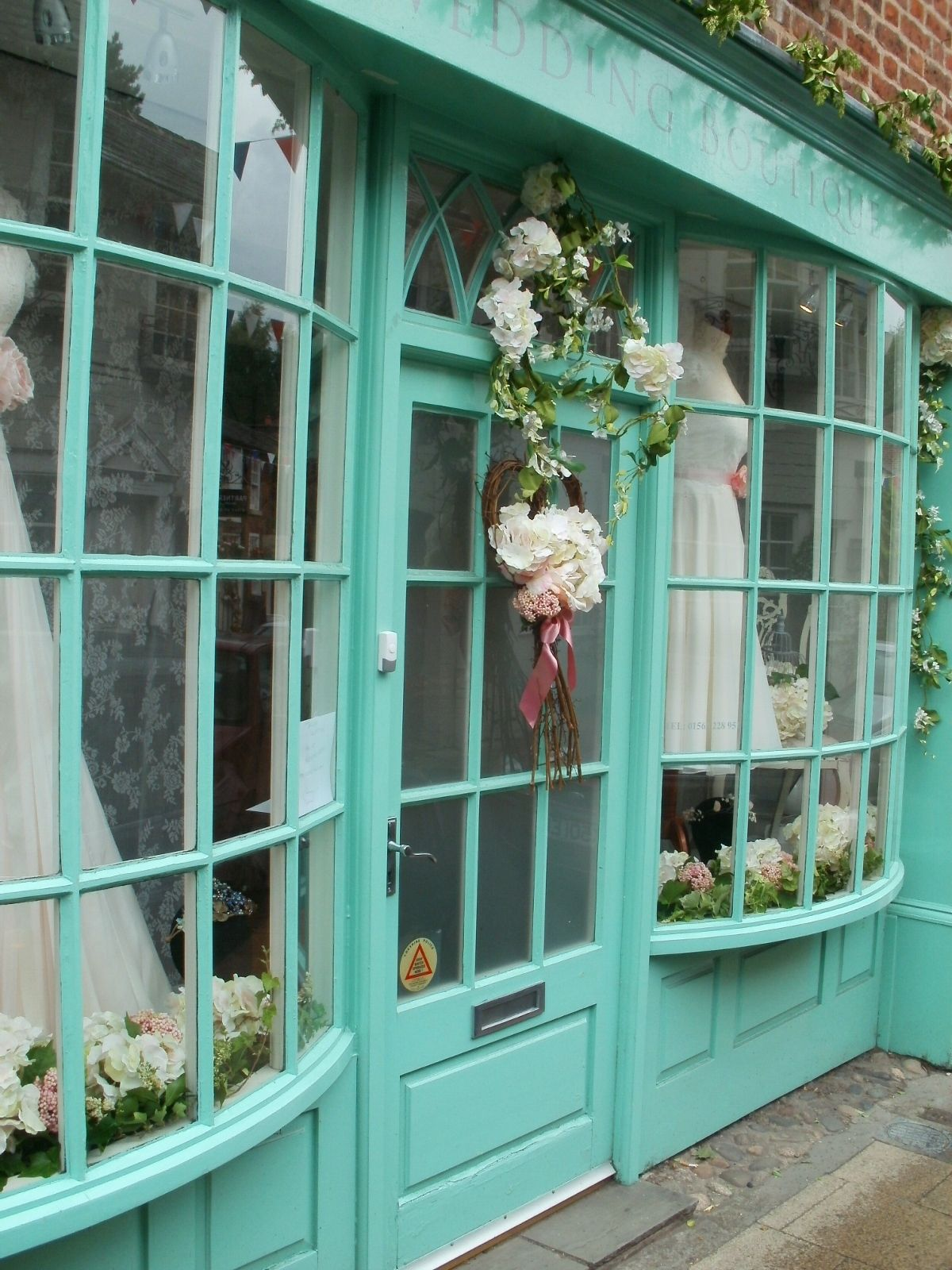 Decorations outside wedding dress shop, King Street,… | Knutsford ...