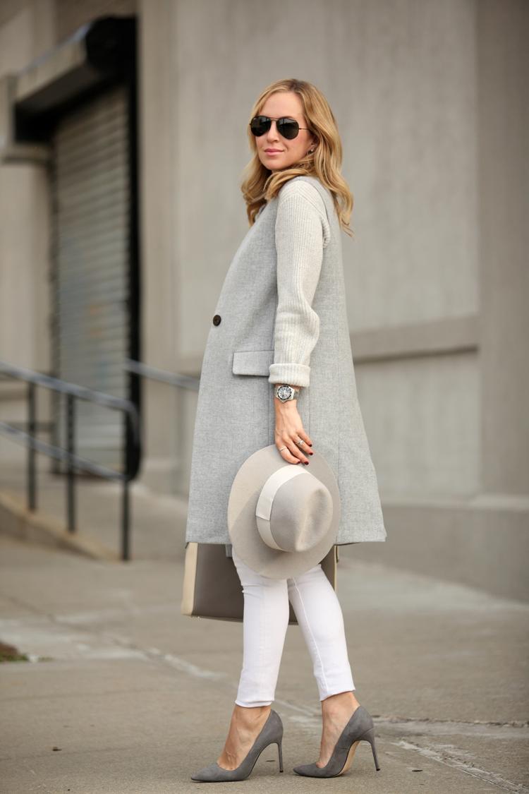 Vest: Intermix (in charcoal) | Sweater: Theory | Denim: Paige | Shoes: Manolo Blahnik | Handbag:...