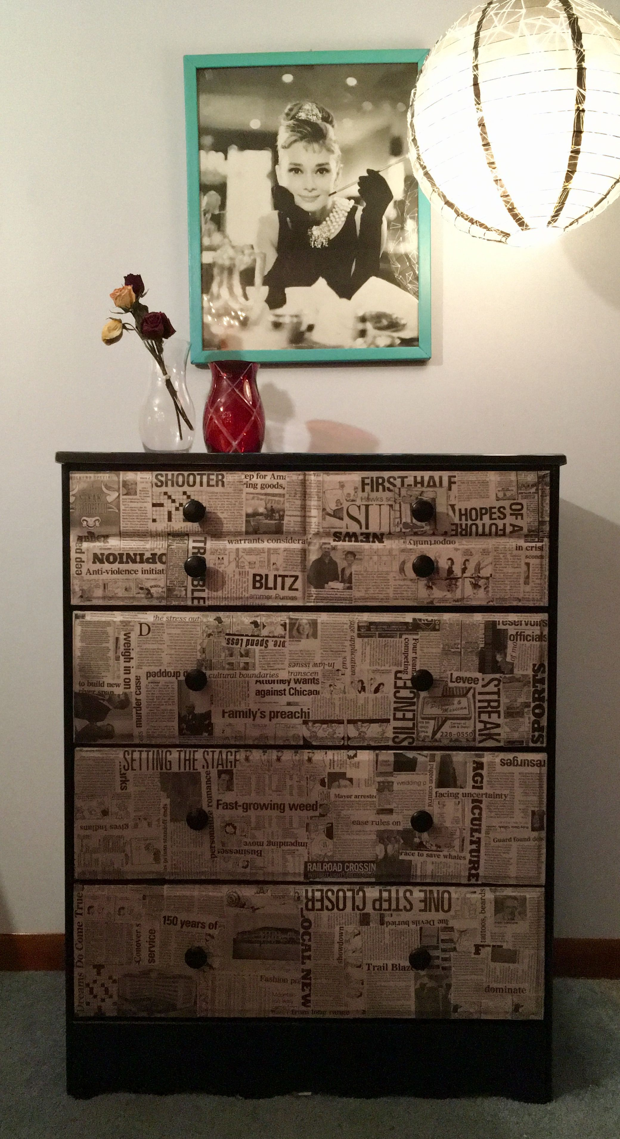 Old dresser I painted then decoupaged with newspaper