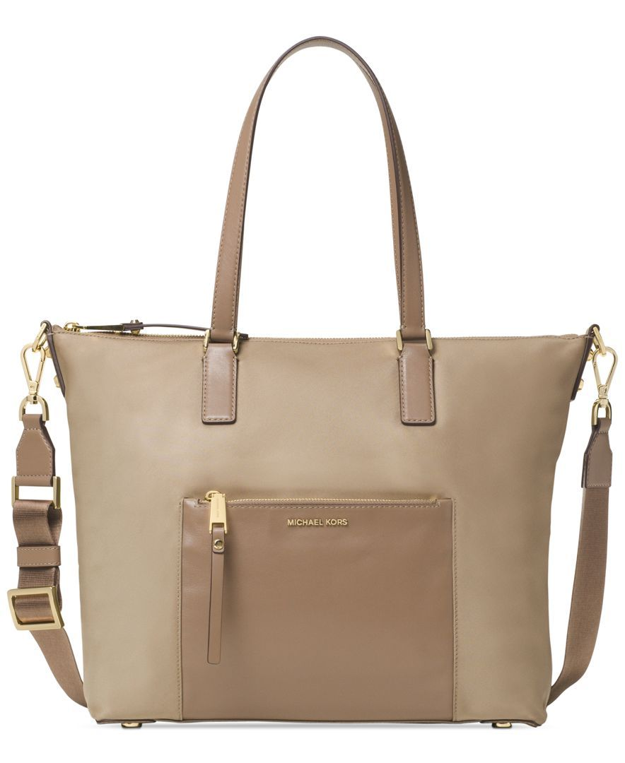 3e18a904952f Decidedly classic everyday chic-this Michael Michael Kors nylon tote pairs  clean lines with plenty of pocket space.   Nylon; lining: polyester    Imported ...