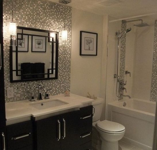 Black and white small tile backsplash with decorative mirror for ...