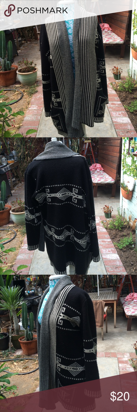 Beautiful long warm graphic sweater black & beige Beautiful long warm graphic sweater black & beige with two front pockets has belt hoops but belt is not attached.  Used lovingly Sweaters Cardigans