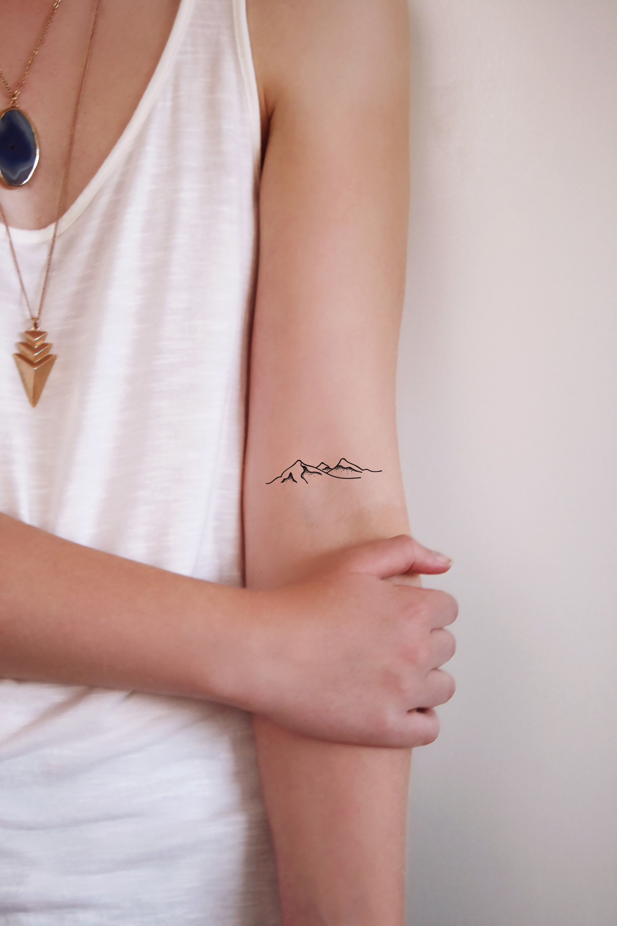 Small tattoo ideas for men on neck a perfect little mountain this would look great on your wrist or