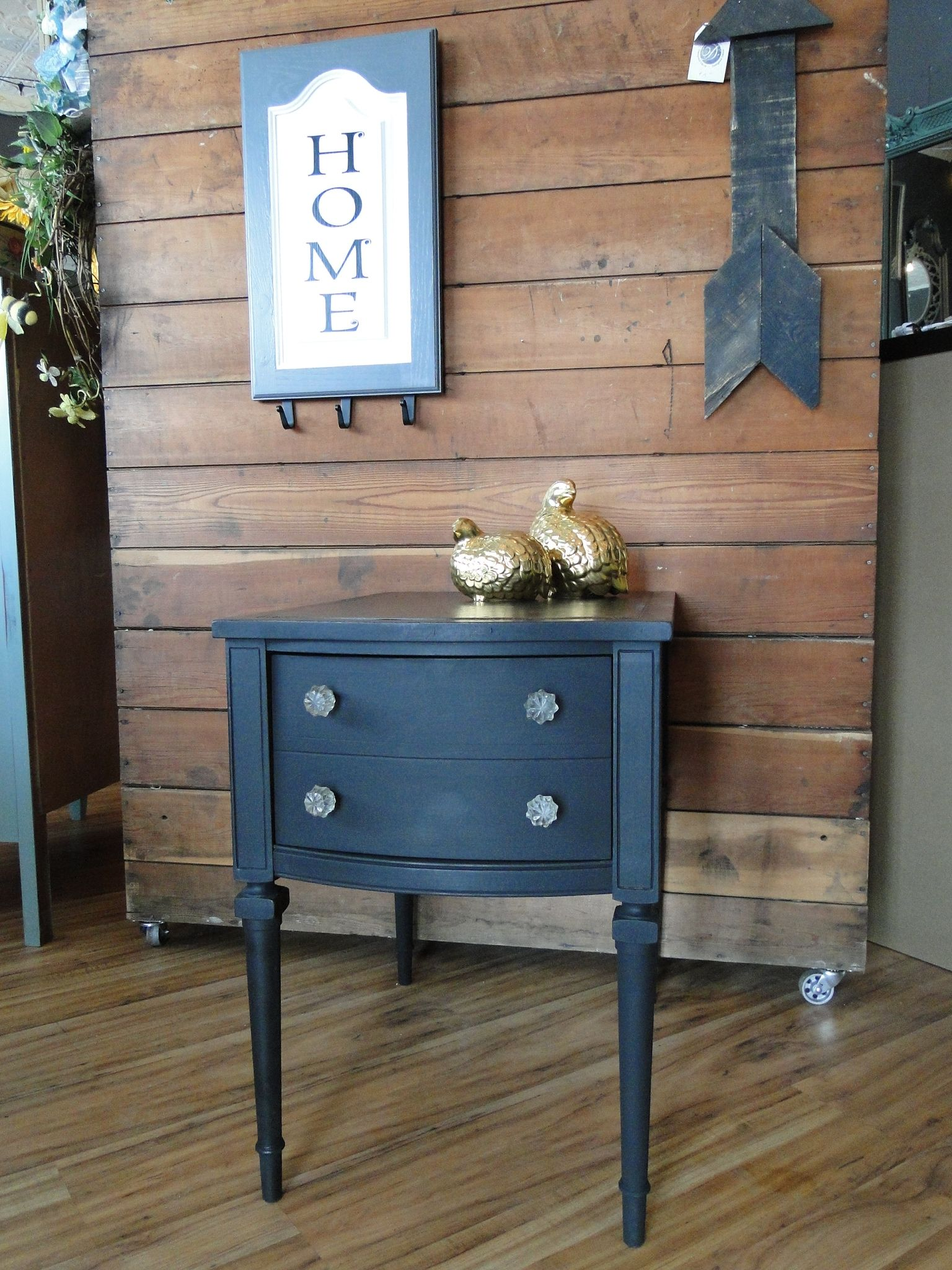 This end table with a drawer was given an uptown treatment with black paint and glass knobs. The top was decoupaged with black and gold floral paper.