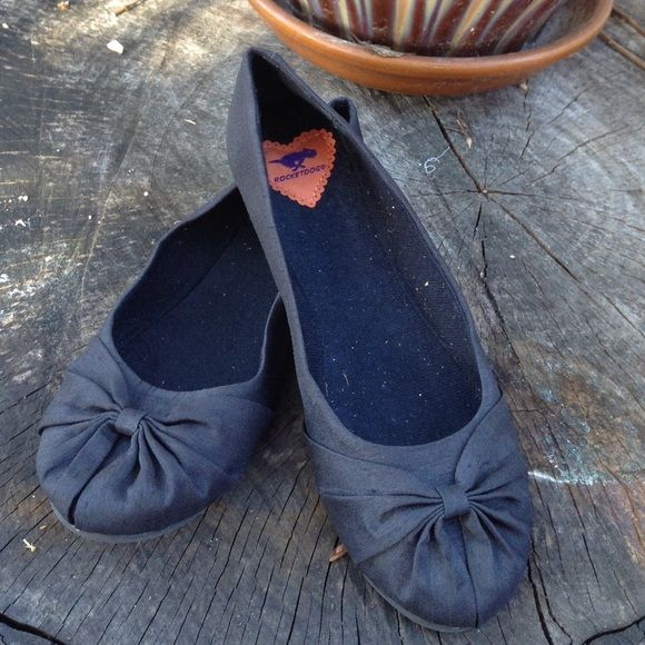 Black fabric flats Super cute with a bow on the toe. Rocket Dog Shoes Flats & Loafers