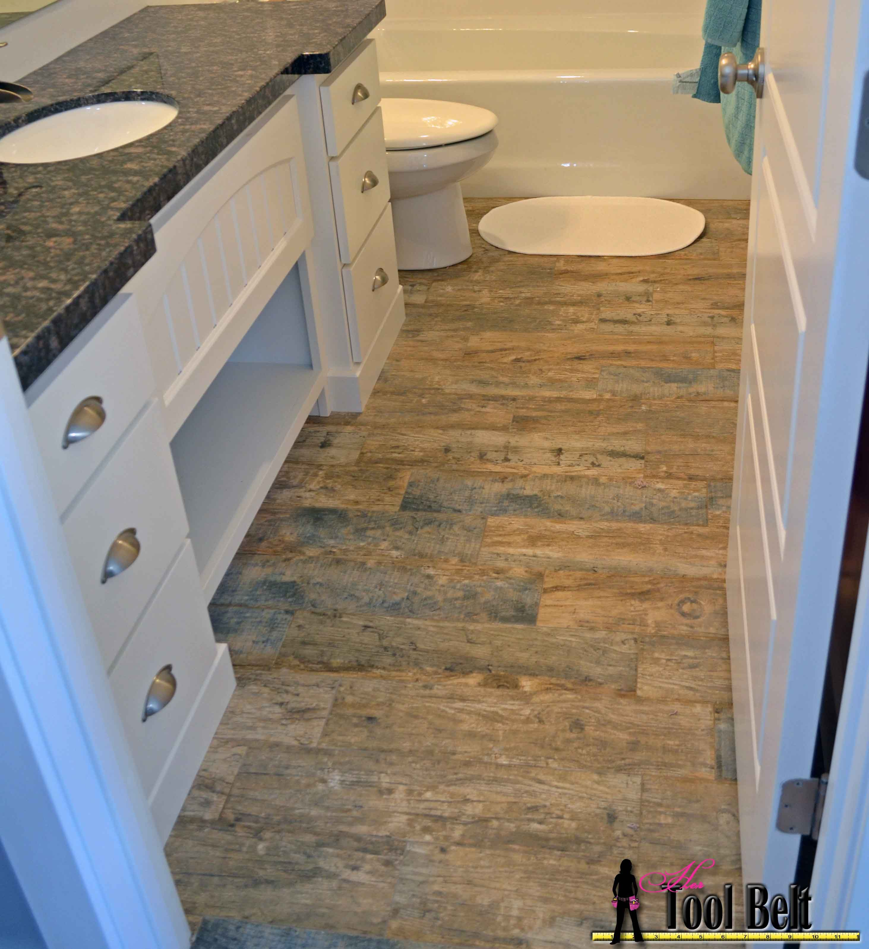 Barnwood tile bathroomg 29263195 pixels a bathrooms step by step tutorial showing how to install faux barn wood tiles this tile looks so good in person and i love the tight grout lines less cleaning dailygadgetfo Choice Image
