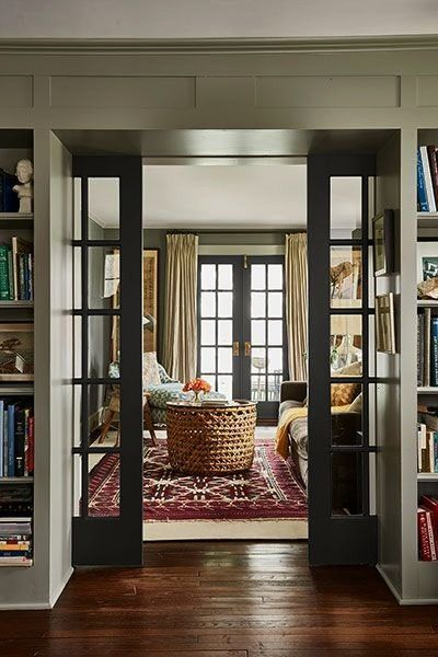True to Form 1929 Farmhouse  French pocket doors lead from the library to a cozy sitting room A True to Form 1929 Farmhouse  French pocket doors lead from the library to...