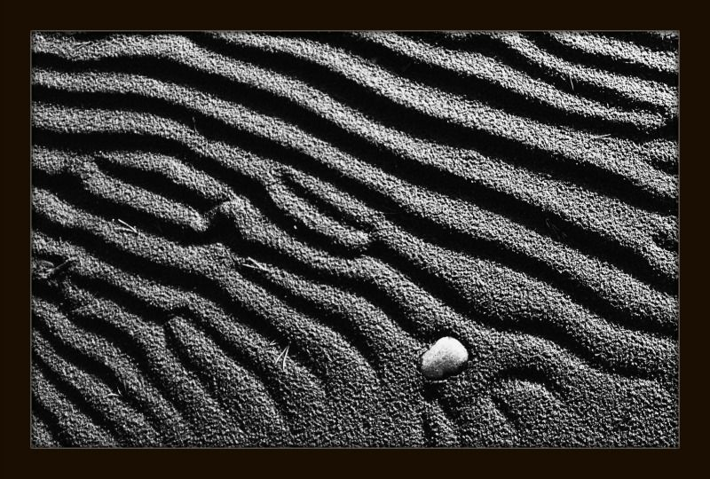 A #rock on #sand #loneliness