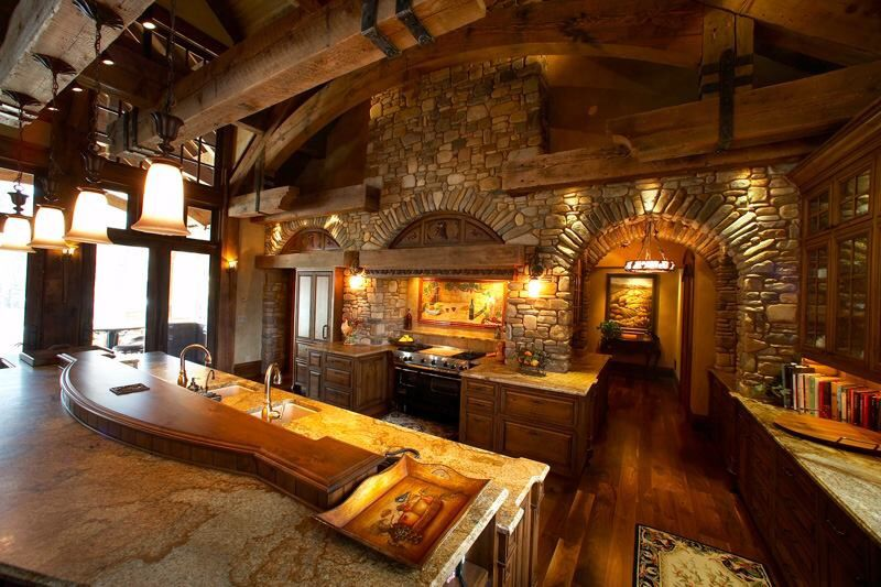 Absolutely in love with this kitchen design! Love the wood, the stove, the rustic look. The stone. I love it all!!!