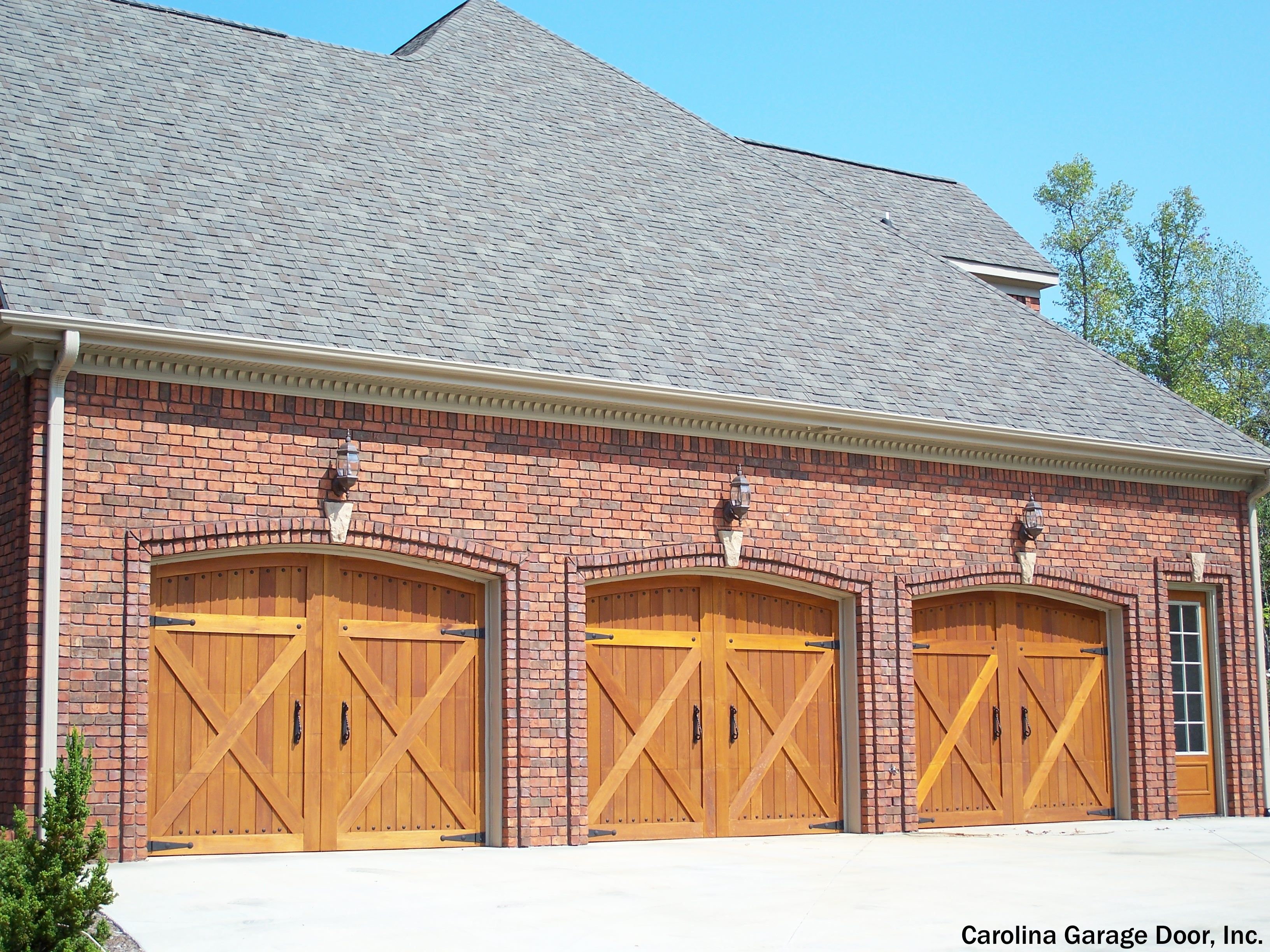 Wood Garage Doors For A Brick House Not Sure The Contrast Works