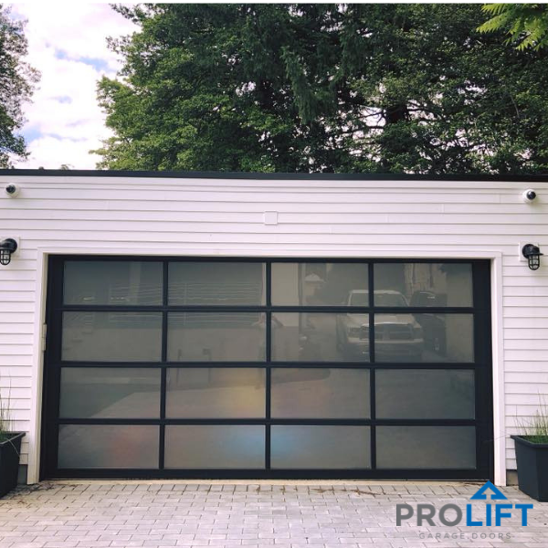 This Clopay Glass Garage Door Is Designed With White Laminate Tempered Panels A Modern Garage Doors Glass Garage Door Garage Doors Modern Garage Doors