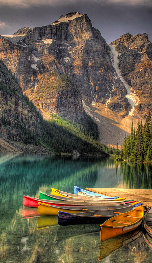Colourful canoes on Moraine Lake at Banff National Park in the Canadian Rockies of Alberta