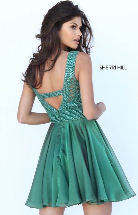 Sherri Hill has the most flattering and fashionable cocktail dresses to  spice up your next party! Style 50517 available at WhatchamaCallit Boutique.