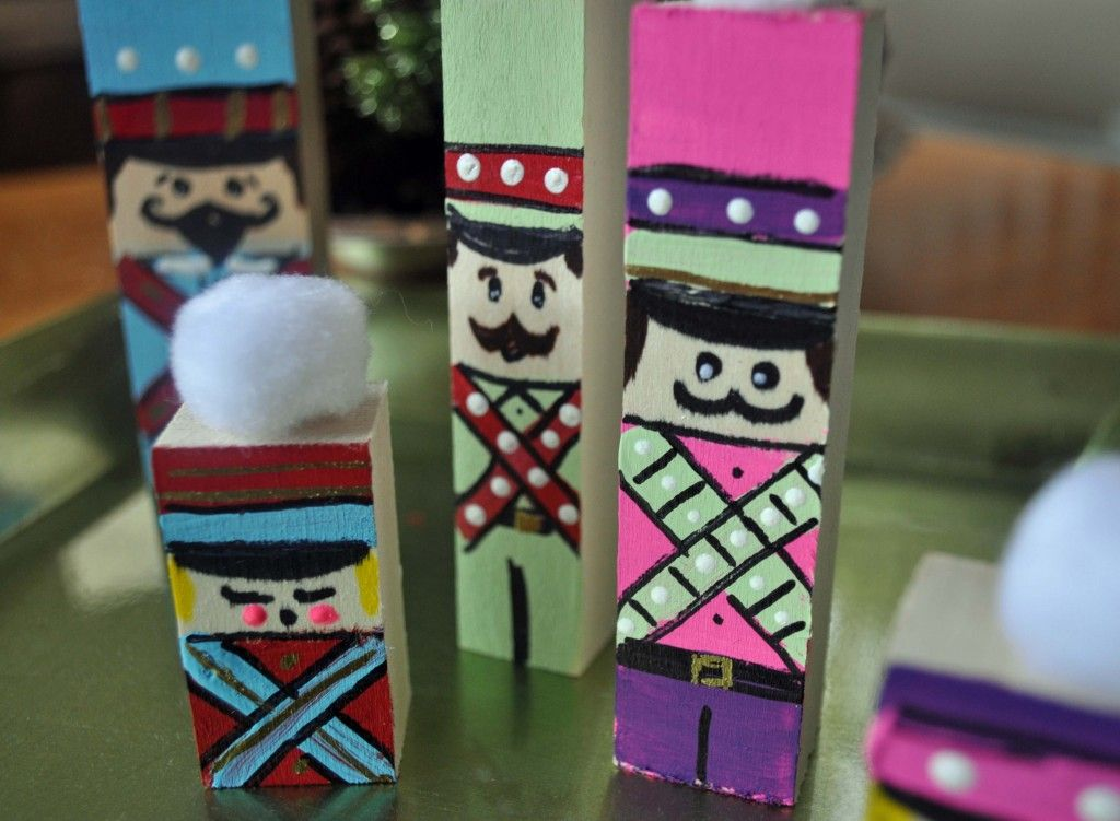 Nutcracker soldiers painted on wooden blocks. (Have also used toothpaste boxes & construction paper!) Add feathers, goggly eyes, pom poms, etc!