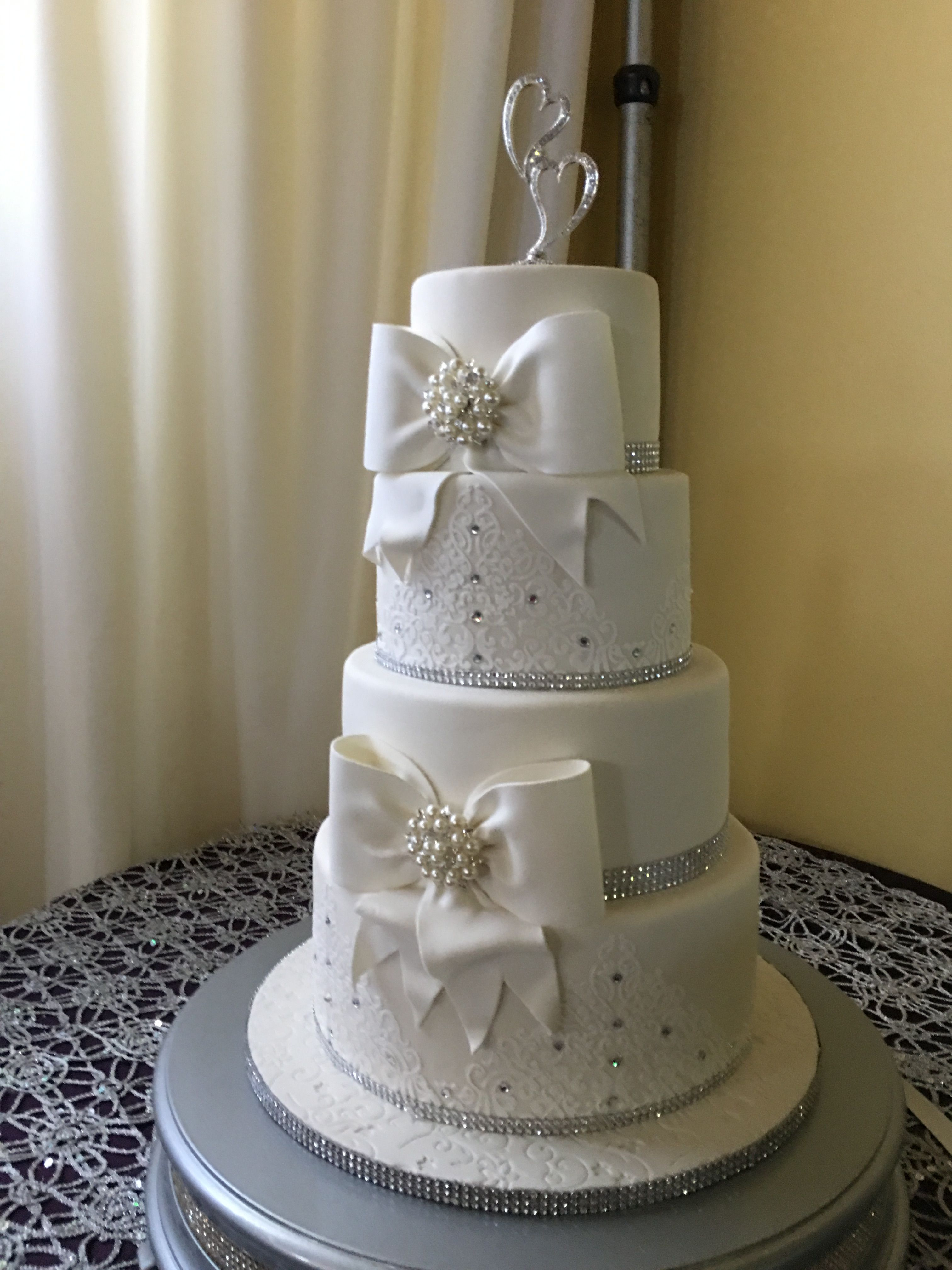 White silver bling and bows wedding cake wedding cakes