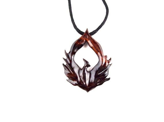 The necklace represents, the firebird prototype that allows anyone to travel to any dimension they want. In the book, Marguerite convinces Theo to go with him on find her dad's murderer. Theo gives her the prototype, and puts it around her neck. The firebird was named after Theo's 1981 Pontiac Firebird, that he rebuilt himself.