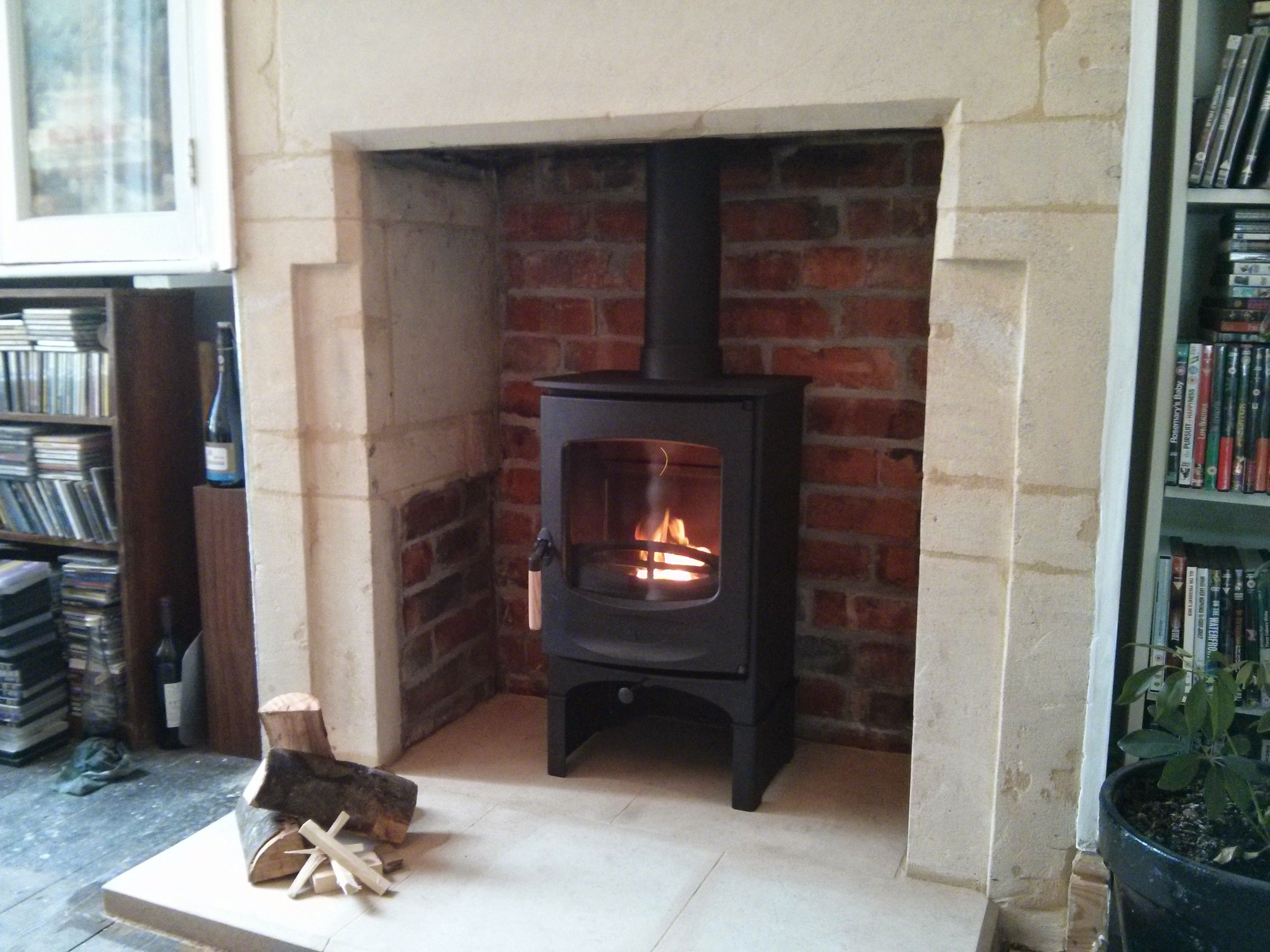 charnwood c4 installed on bath stone hearth fireplace envy