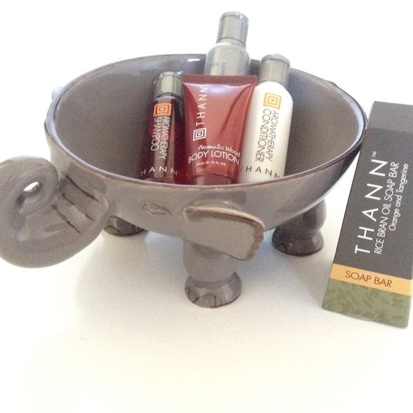 Thann Naturals Bath Bundle Thann natural bath travel size bundle includes rice bran oil soap bar 1.3oz, aromatic wood shampoo & conditioner 1oz each, body wash 1.25oz, and vitamin E quick absorbing moisturizer .75oz. All brand new unused; the soap is an asymmetrical design and meant to look like that. Bundles discounted, smoke-free home. Thann Makeup