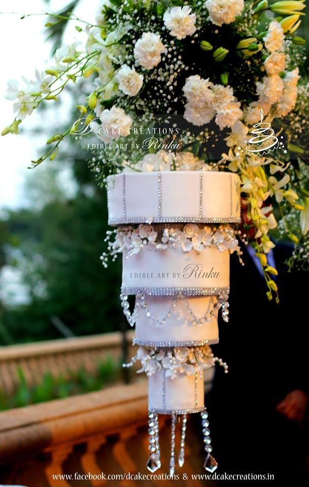 Four tier chandelier wedding cake hanging upside down on a stand four tier chandelier wedding cake hanging upside down on a stand the cake was decorated mozeypictures Image collections