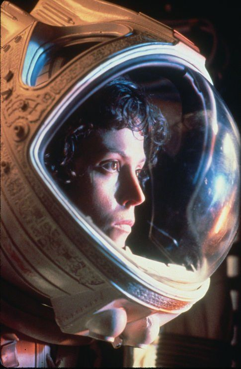 Alien's Ellen Ripley, played by Sigourney Weaver. Written by Dan O'Bannon. Directed by Ridley Scott. (And then revisited in the rest of the Alien franchise.)