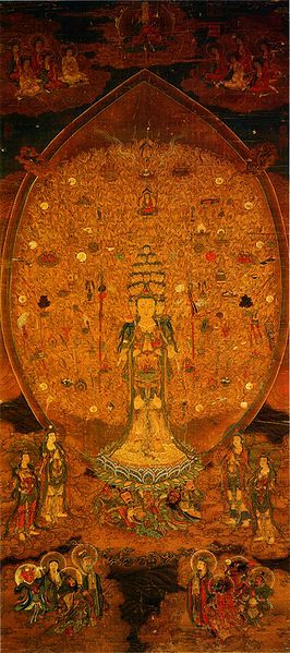 Kwan Yin represented with several bodhisattva heads topped by a Buddha head. the figure is standing on a lotus pedestal held up by four heavenly kings. A pair of bodhisattva attendants flank the figure on each side. Seated Buddhas are in clouds above the figure. Eight Deva kings appear below the figure. Ink and colors on silk. 79.2 x 176.8 cm. Museum item 02.08.00157