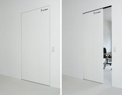 Linvisibile Motorized Concealed Sliding Door. Mouvement Detail Of The Door  Finished As The Wall.