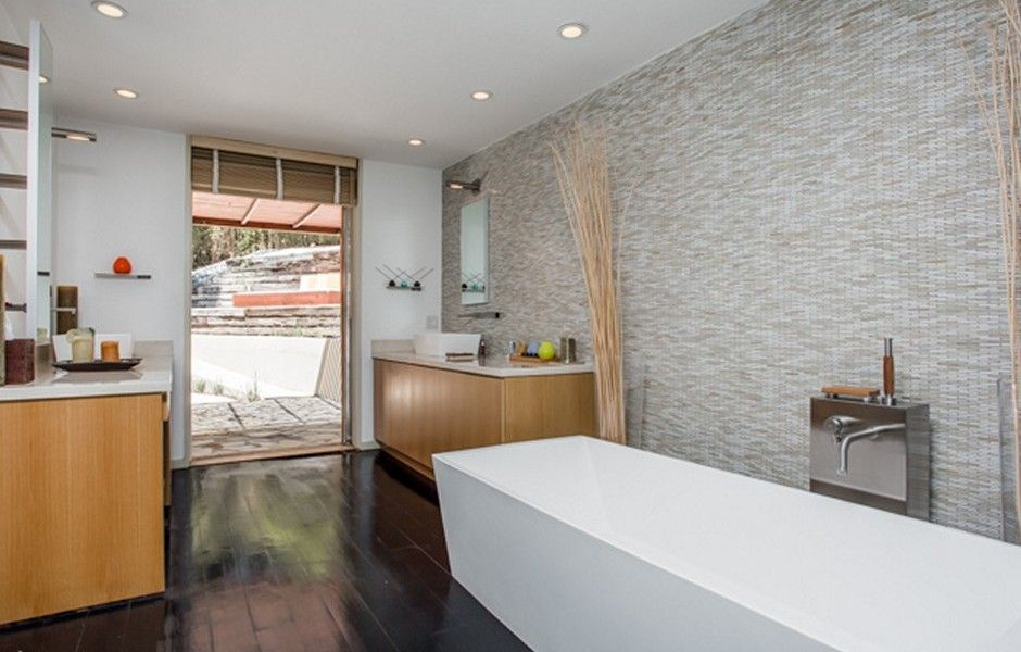 A spa like bathroom with a large soaking tub, tiled wall detail and ...