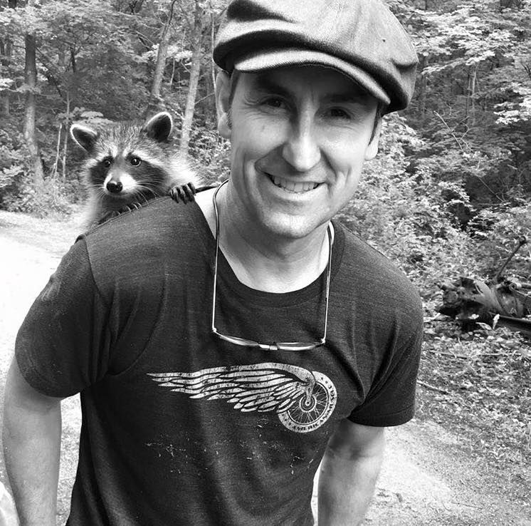 Mike Wolfe American Picker With Racoon