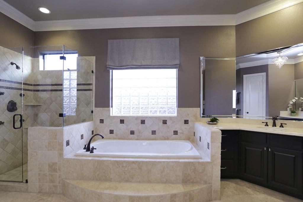 Master bath includes a jacuzzi tub with glass block window for Master bathroom jacuzzi