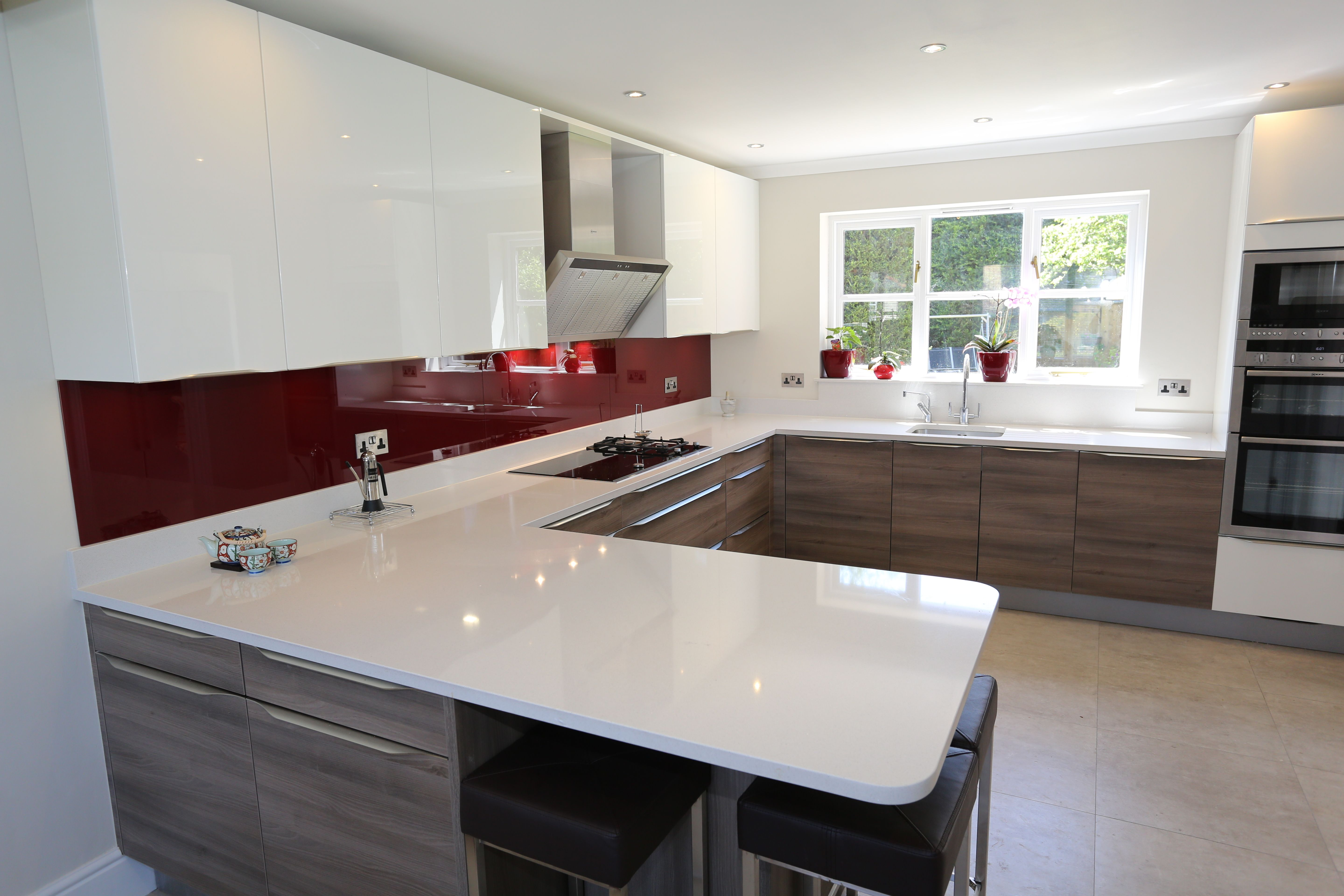 Shiny White and grey acacia wood kitchen by Hacker at The Kitchen ...