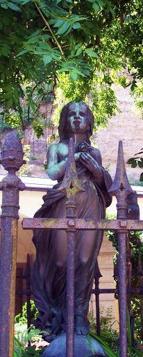 Statue on a child's grave in Salzburg, Austria.