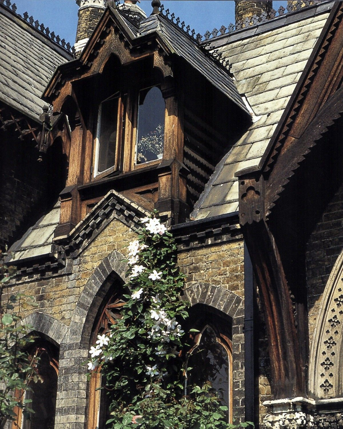 The stunning facade of a rustic gothic revival home for Casa revival gotica