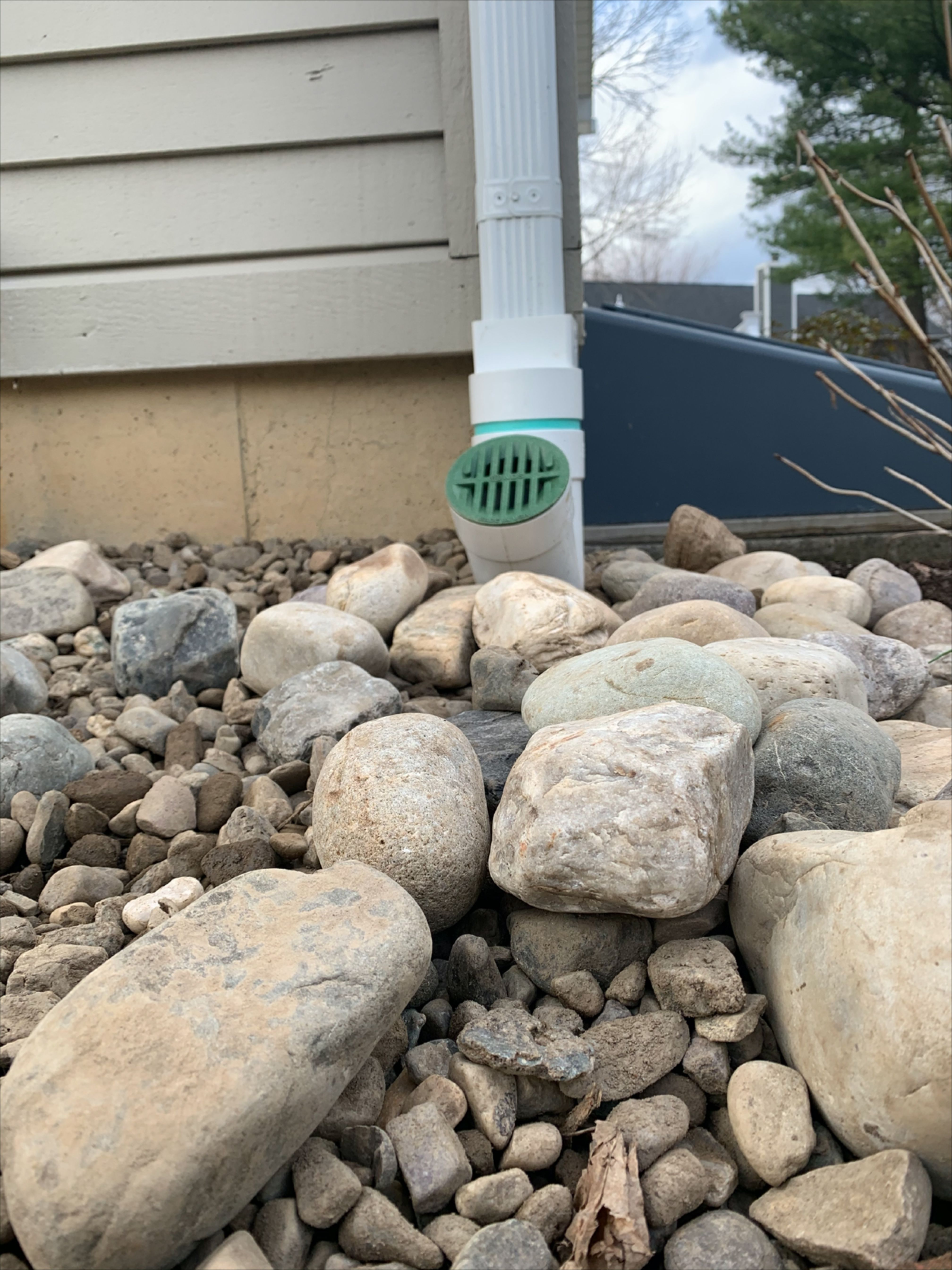 Extending Gutter Downspout With Drainage Rainwater Piped Away From Foundation To Prevent Leaks In 2020 Underground Drainage Drainage Sump Pump Installation
