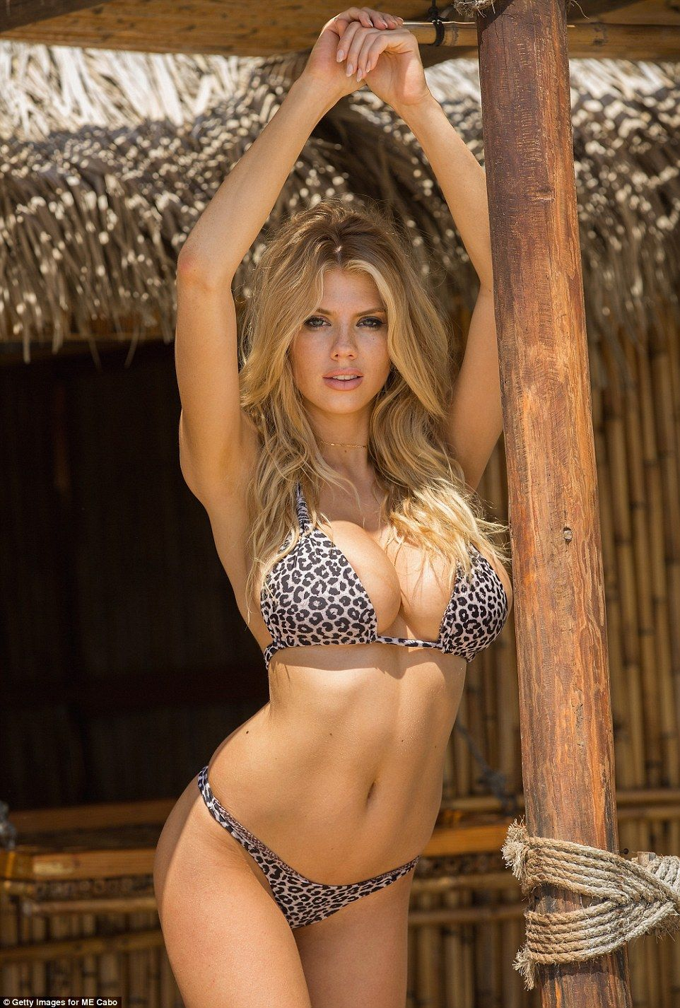 635bfcf6bb940 Knock their spots off in a leopard print bikini by Acacia Click visit to  buy