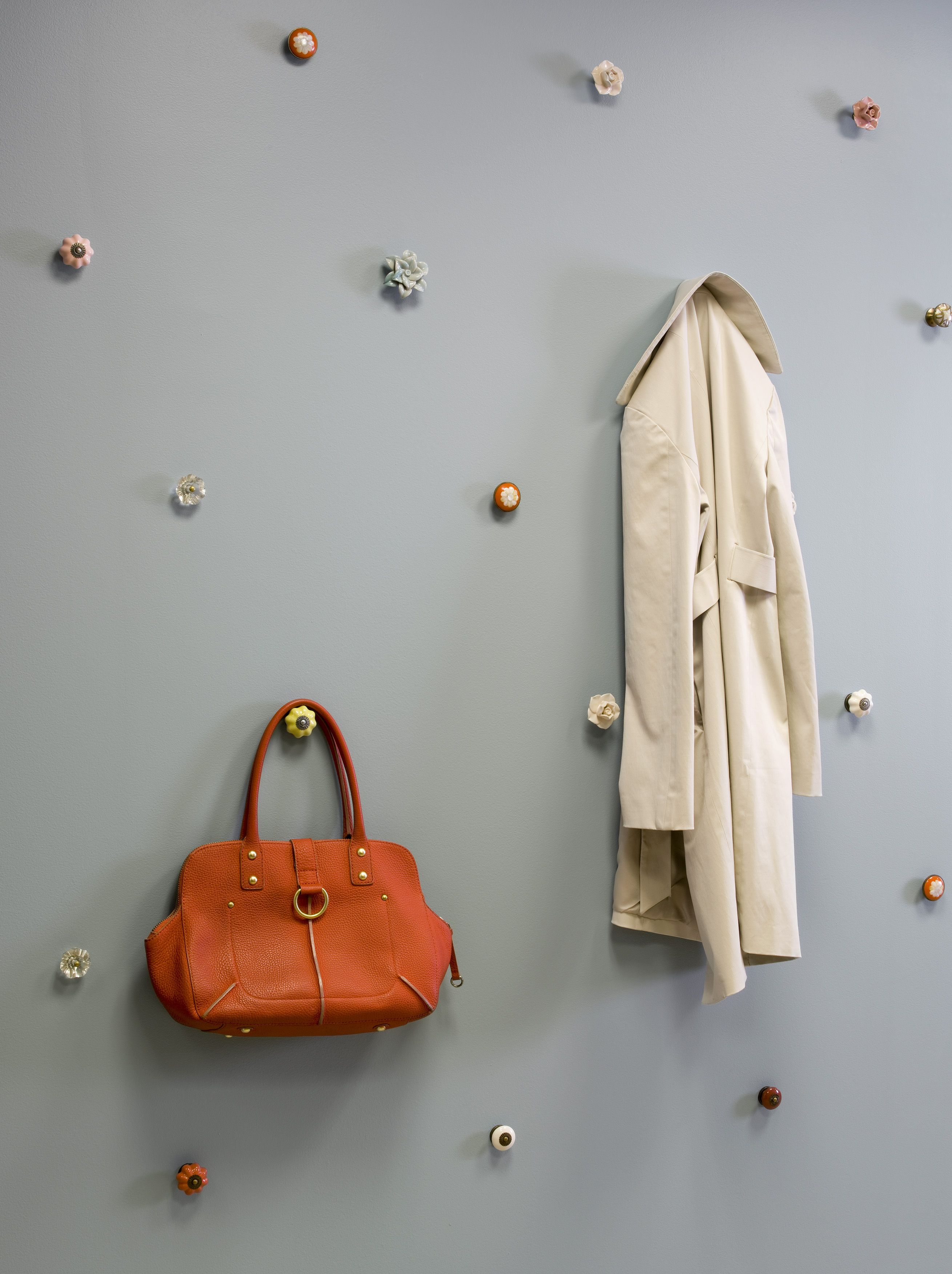 Hallway storage for coats  Wall of decorative knobs provides the perfect aesthetic solution for