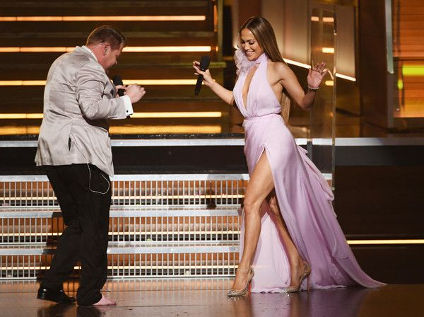 Host James Corden (L) greets recording artist-actor Jennifer Lopez onstage during The 59th GRAMMY Awards at STAPLES Center on February 12, 2017 in Los Angeles, California.