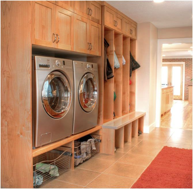 Mud room entry way with washer and dryer built into the wall