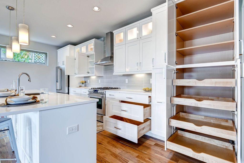Contemporary Kitchen With Limestone Counters Pendant Light Stone