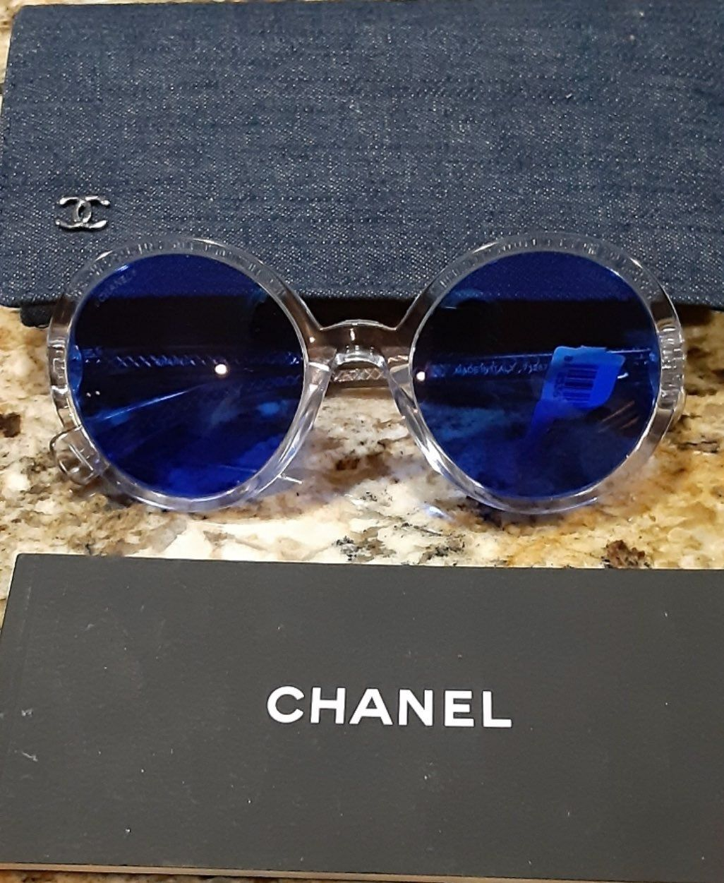 NEW, AUTHENTIC CHANEL Sunglasses. Transparent Frame. Blue