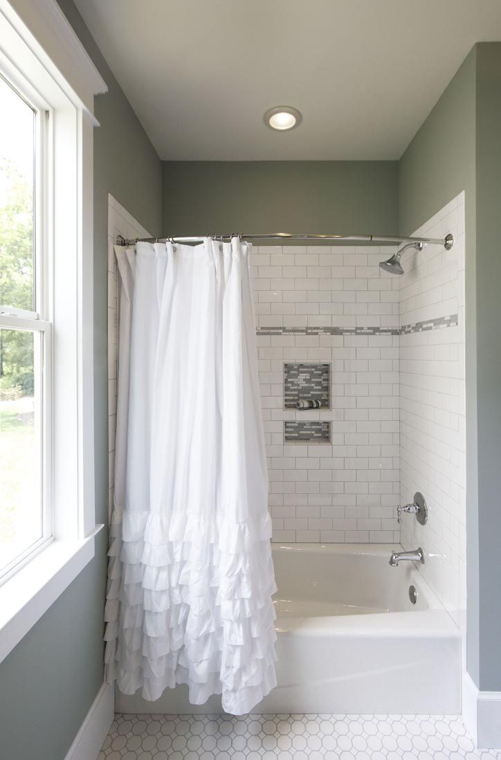 Sea foam green bathroom with white subway tile in the shower and ...