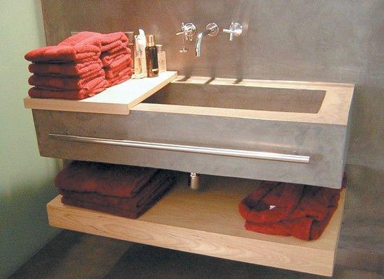 Ba o con pileta y pared en microcemento griferia y for Griferia pileta bano