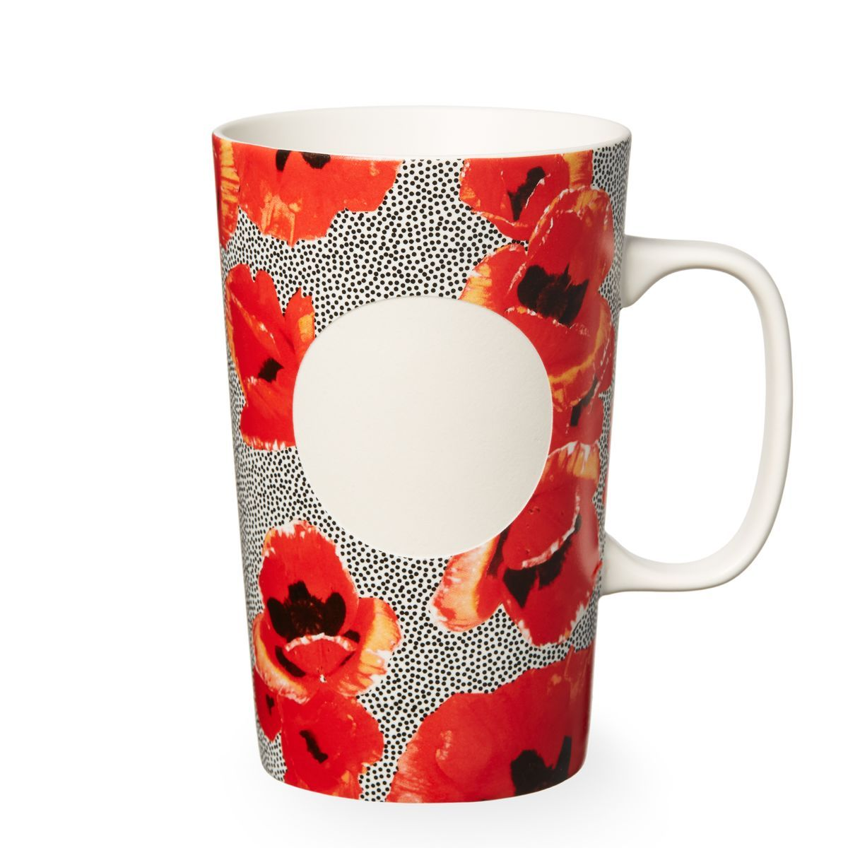 A ceramic coffee mug adorned with poppies and dotted with seeds ...