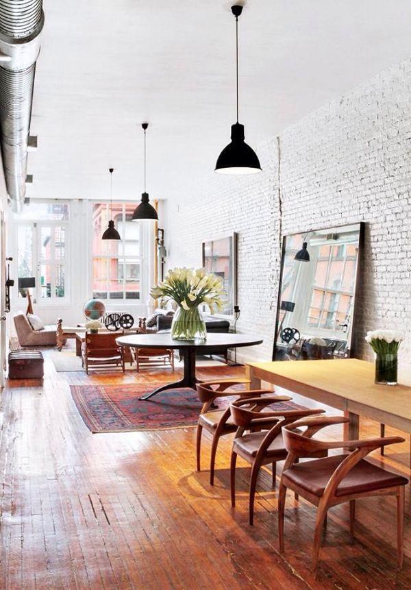 Whitewashed brick, vintage wood floors, eclectic mix